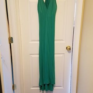 Floor length gown in green. Backless